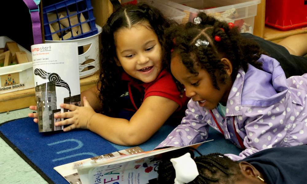 Four Fun Reasons to Take Your Children to the Library Today! - two little girls reading