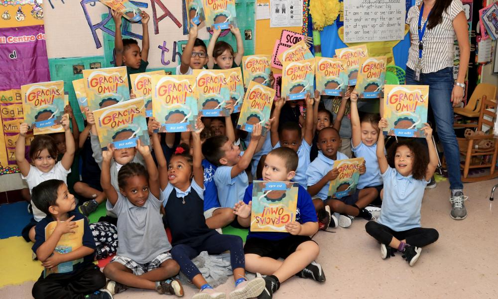 "Group picture of children holding up the book ""Thank You, Omu"" for Broward: Read for the Record 2019"