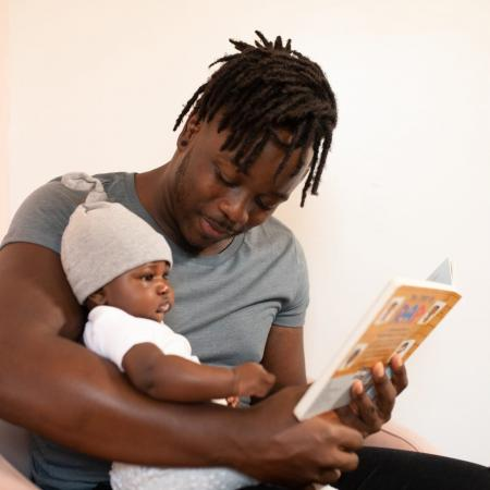 Father reading to baby.